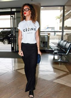 Rihanna rocking a Cèline tee shirt with a black maxi skirt, big glasses, red lips, skull heads bangle and a slave bracelet