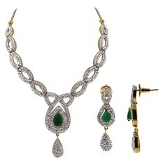 Gold Plated Faceted Teardrop Emerald Color with Clear CZ Earrings Necklace Set. The necklace 12 to 14 inch long adjustable and comes with S-hook clasp. The earr