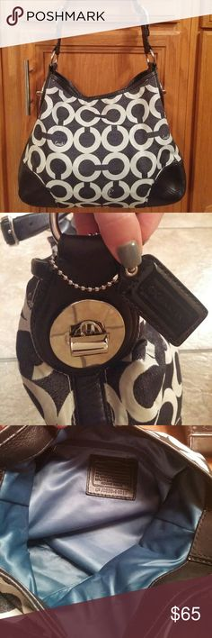 """Coach purse handbag shoulder bag Awesome and bold!  Black and white Coach purse with the signature C's and 'Coach' written in script.  Black leather trim, bold silver hardware, and a thick black adjustable strap makes this bag a winner!  Beautiful rich blue interior lining!  Measures 15"""" at the widest point at the bottom and 10"""" high.  This bag has room to carry everything you need!  Priced to sell! Coach Bags"""