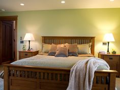 Light green paint in the master bedroom of this Craftsman style home. The room is kept clean and classic with elegant wood furniture and neutral linens. Sage Green Walls, Green Accent Walls, Green Accents, Grey Walls, Luxury Bedroom Furniture, Furniture Decor, Green Master Bedroom, White Bedroom, Master Bedrooms