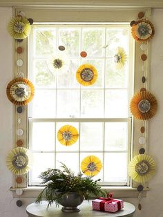 Give any room a spirited lift with this bright and funky Christmas garland! Find more garland ideas here: http://www.bhg.com/christmas/garlands/holiday-garland-ideas/?socsrc=bhgpin120714colorfulmedallionwindowgarland&page=29
