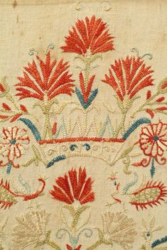A fragment from a C 18 Cretan skirt border with some motifs derived from Italian renaissance art and others from Byzantine art. Mostly embroidered in feather stitch. The color of this embroidery is particularly rich in nuance.