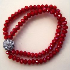 I just put it on sale - it was $24.99!    Red faceted double row slip on trendy fashion bracelet. It's faceted fiery red glass.   Great for Valentine's and beyond.    Will come in fancy drawstring organza pouch or gift box.    FYI:     As soon as payment clears, we ship within 2 business days by USPS First Class with delivery confirmation number     {1444B;1446B;1447B;1448B}