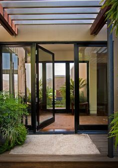Front door courtyard | Translucent Glass Entry Door Design Ideas, Pictures, Remodel, and ...
