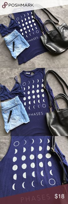 Earthbound Moon Phases Shirt - Small Earthbound Trading Co. Moon Phases Blue Tank - no flaws or defects. For your inner moon child. Represent the phases of the moon with this loose fitting, dark navy tank featuring a rounded neck with a small key hole opening in the back.  CONTENT AND CARE:  95% Rayon, 5% spandex   Machine wash cold. Tumble dry low.  check out the other items in this listing! I accept reasonable offers - Bundle & Save! No Returns - Happy Shopping! Earthbound Tops Blouses