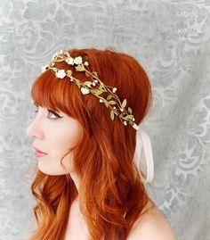 Boho bridal crown, flower hair wreath, woodland headpiece, wedding hair accessories. $64.00, via Etsy.
