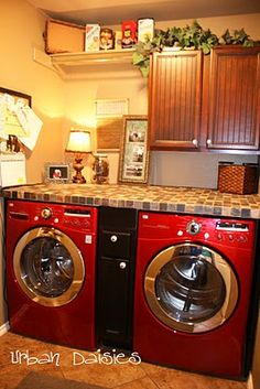 I love this laundry room idea. So smart to use your front loaders as a base for a folding station.