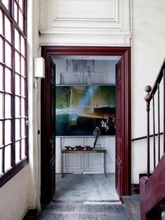 deep, rich lacquer defining a jewel~box entry space