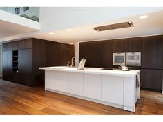The wood color of the kitchen can also be used for the living room