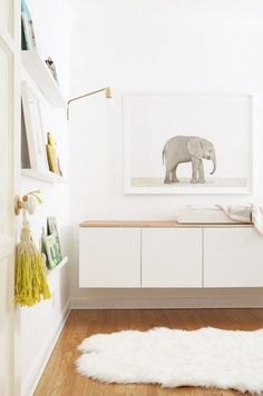 Nursery with a oft wall hanging and snuggly, high-pile rug