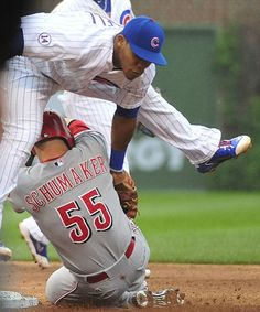 Addison Russell, CHC, tags out Skip Schumaker, CIN/ JUne 2015