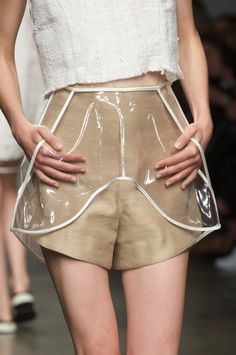 Gold silk shorts with clear plastic pocket detail; transparent fashion details // Osklen Spring 2015