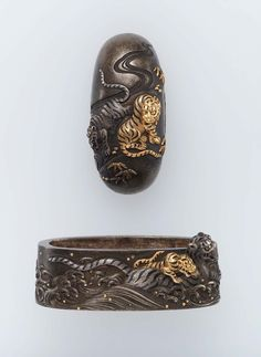 Fuchi-kashira with designs of tigers and waves. Edo period–Meiji era mid to late 19th century - Takeda Nobutoshi (Japanese, born in 1834), Ito School http://www.mfa.org/collections/object/fuchi-kashira-with-designs-of-tigers-and-waves-12471