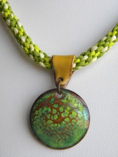 Enamel Pendant and Silk Cord Kumihimo Necklace  Colors: Lemon Sherbet, Lime, Pea Green and Toast Brown. $27.00, via Etsy.
