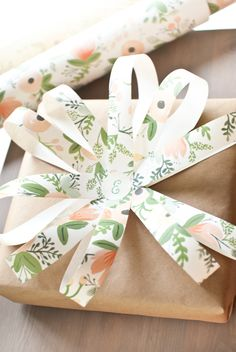 Here's a use for wrapping paper ends - cut them into strips and make a paper bow gift topper.