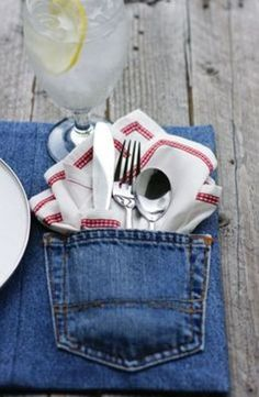 Denim placemats.  I'd use a red paisley hanky for the napkin and make it look COUNTRY!