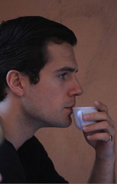 Henry...I wish it was ME against those lips and NOT that little tea cup...