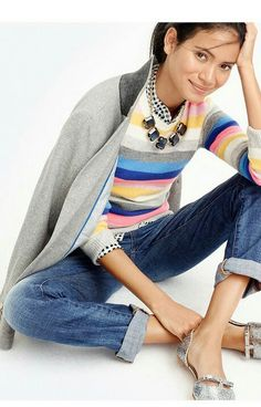 Multi-colored stripe top, grey blazer, jeans and silver metallic flats.