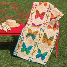 """Make a beautiful orchestra of butterflies in this GO! Butterfly Patch Quilt. Have an applique party while experimenting with embroidery in this design by Edyta Sitar. Fabrics are """"Edyta's Essentials"""" by Moda Fabrics."""