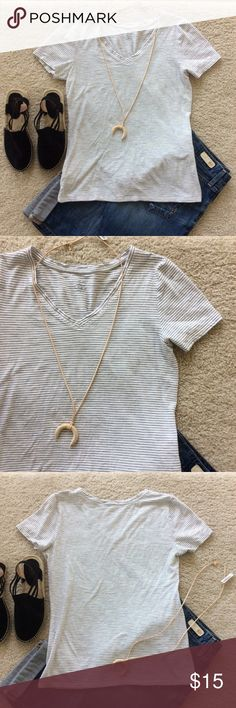 """LOFT Short Sleeve Tee LOFT Short Sleeve Tee. Super cute wardrobe staple. White with black pin stripe. V neck. Laying flat approx 23.5"""" shoulder to hem, approx 17"""" pit to pit. 100% cotton. Size S. Great condition. #S8 LOFT Tops Tees - Short Sleeve"""