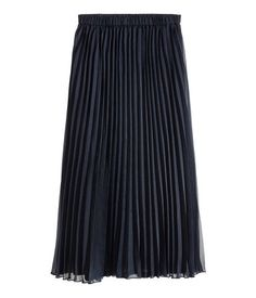 Dark blue. Calf-length, pleated skirt in airy woven fabric with an elasticized waistband. Lined.