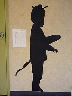 Fairy Tale silhouettes all over the library with book references next to them
