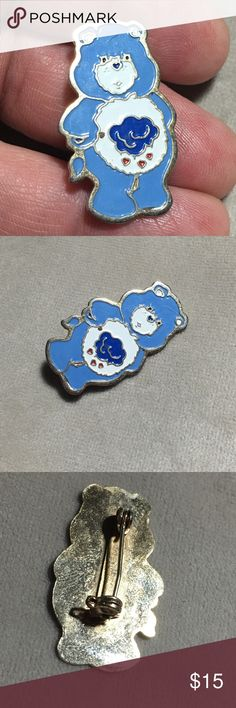 """Vintage 1983 Grumpy Bear Care Bear Pin Vintage throwback. 1983 Grumpy Bear Care Bear Pin. Shows it's age with some wear and surface scratches. Gold tone back. Measures 1.25"""" X .75"""". Vintage Jewelry Brooches"""