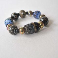 A personal favorite from my Etsy shop https://www.etsy.com/listing/210460278/chunky-blue-bracelet-lampwork-bracelet