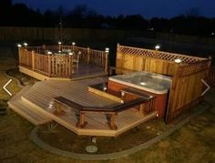 Hot tub spot with colored wood planks in various stain colors and lights.