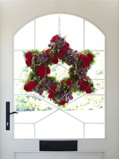 Star shaped Christmas wreath with red flowers