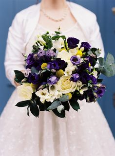 Cecilia & Rob: wondeful bouquet of purple lisianthus, white freesias, cream roses, craspedias, eucalyptus and hypericum berries