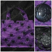 """This bag is the perfect size for toddlers on their Spooky night out.   It is made of 100% cotton with coordinating lining. It measures approximately 9"""" x 7.5"""" with 9"""" handles.  For added spookiness there is a spider engraved in the snap closure."""