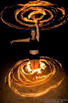 Krystin Railing Double Fire Hooping. Krystin Railing of Circus Mafia spins double fire hooping in San Diego. Photo by Robert Stone Nadel Photography.