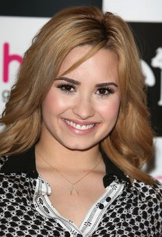 Hair Lookbook: Demi Lovato wearing Long Wavy Cut (5 of 12). Demi Lovato chose soft wavy tresses for her look at the promotion event for her new album.