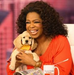 "•""Oprah's and her dog Sadie, who was adopted from PAWS Chicago, a no-kill animal shelter"" •"