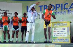 """Ivorian cyclist Soto Poroloh performs the """"Coupé décalé"""" dance on the podium of the first stage of the Amissa Bongo cycling race. 4 Life, Cycling, Stage, Bicycle, In This Moment, Dance, Baseball Cards, Sports, Cutaway"""
