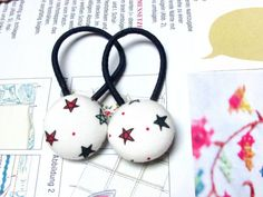 Check out this item in my Etsy shop https://www.etsy.com/listing/245668910/button-ponytail-holders-marine-ponytail