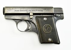 CZ Ceska Zbrojovka 1922 6.35mm caliber pistol. Rare Czech .25 auto pistol designed by Alois Tomiska in 1922 and was derived from an earlier Tomiska designed fox pistol in 1918. These were the first CZ pistols to carry the CZ trademark. Gun has approximately 95% blue. Bore is worn. Action works perfectly. (Magazine is probably a replacement but fits the gun well.)