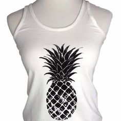 """White & Black Racerback Pineapple Tank Top PLEASE DO NOT PURCHASE THIS LISTING!  I have 1 Large, 2 medium, and 2 small available.  COMMENT WITH YOUR SIZE AND I WILL MAKE YOU A SEPARATE LISTING!   NWT.  100% Cotton.  Adorable white racerback tank top with black pineapple print.  Stretchy, scoop neck, great quality.  Approximate measurements laying flat:  Large=chest 17"""", length 26"""" Medium=chest 15"""", length 25"""" Small=chest 14"""", length 24"""". Iconic Legend Tops Tank Tops"""