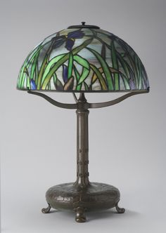 ** Tiffany Studios, New York, Favrile Leaded Glass and Patinated Bronze Lamp.