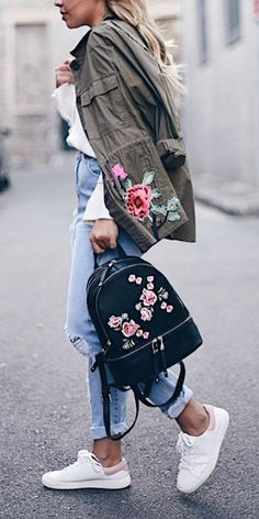 Ashley + embroidered coat + backpack + perfect match + beautiful floral patterning + shades of fuchsia + pale pink + green + fresh look + perfect for spring + rolled denim jeans + white sneakers.   Jacket: Forever New.