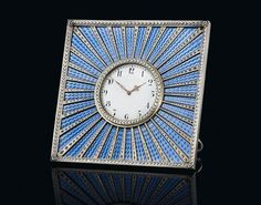 Fabergé's workmaster Mikhail Perkhin made this silver gilt and enamel desk clock in about 1890. Of square from, it is enamelled in translucent blue over a wavy sunburst guilloché ground to which radiating tapering bands have been applied. The circular silver laurel-wreath bezel encloses a white dial with Arabic chapters and pierced gold hands. The clock is 10.7cm (4.2in) high. It is estimated at £100,000-150,000 (US$160,000-230,000; €120,000-170,000).