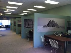 Beautiful wall murals add excitement to a travel agency.