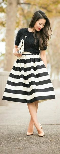 Super gorgeous look. Black textured top, midi striped skirt, nude pumps.