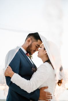 Beautiful bride and groom portrait with flying veil // Nazrul and Ameera's Desert Prewedding Among Western Australia's Ancient Rock Spires