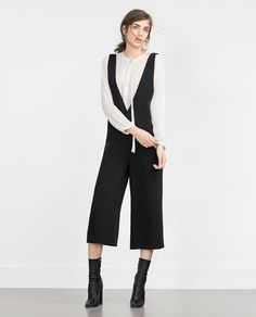 LOW-CUT JUMPSUIT from Zara.  Cool look with a silk blouse or sweater layered underneath.