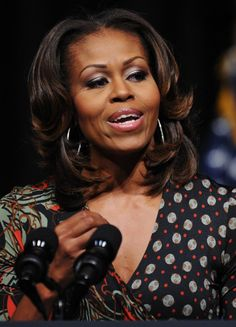 Pin for Later: 18 Reasons Michelle Obama's Hair Is National News November 2013 Michelle is far beyond her fringe now and is currently wearing her hair with a middle part and feathered à la Farrah Fawcett.