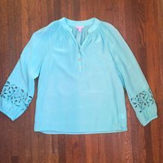 Lilly Pulitzer silk Elsa top I love the cut out details on this classic Elsa top. Great silk material and such a pretty summer color. Excellent condition. Lilly Pulitzer Tops