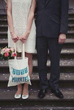 Lovely bride and her Just Married bag!    Photography by the fantastic Lisa Devlin - devlinphotos.co.uk