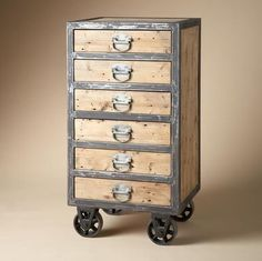 "Reclaimed English pine highboy is durably crafted of wood and steel on heavy metal casters. Made with recycled materials from the era of industrial design, when mills were mills and men were men and buildings were built to last. Handsome six-drawer silhouette with bin pulls. 24""W x 20""D x 46""H."
